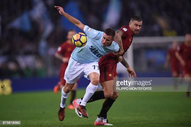 Lazio's midfielder from Montenegro Adam Marusic fights for the ball with Roma's Croatian defender Aleksandar Kolarov during the Italian Serie A...