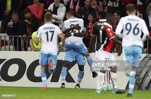 Lazio's midfielder from Serbia Sergej MilinkovicSavic celebrates after scoring a goal during the UEFA Europa League football match between Nice and...
