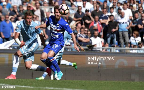 Lazio's midfielder from Serbia Sergej MilinkovicSavic fights for the ball with Sampdoria's midfielder Daniel Pavlovic during the Italian Serie A...