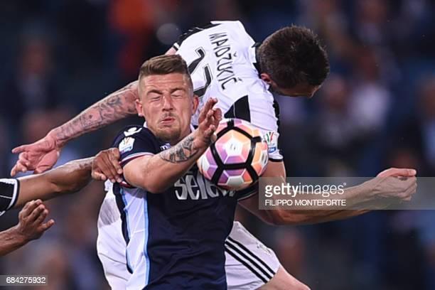 Lazio's midfielder from Serbia Sergej MilinkovicSavic fights for the ball with Juventus' forward from Croatia Mario Mandzukic during the Italian Tim...