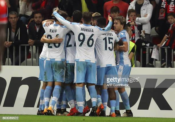 Lazio's midfielder from Serbia Sergej MilinkovicSavic is congratulated by teammates after scoring a goal during the UEFA Europa League football match...