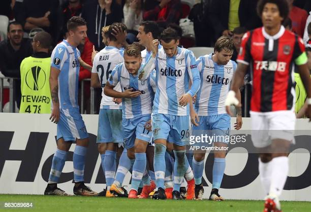 Lazio's midfielder from Serbia Sergej MilinkovicSavic is congratulates by teammates after scoring a goal during the UEFA Europa League football match...