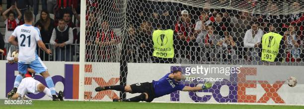 Lazio's midfielder from Serbia Sergej MilinkovicSavic scores a goal during the UEFA Europa League football match between Nice and Lazio on October 19...