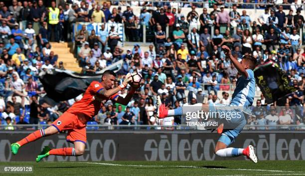 Lazio's midfielder from Serbia Sergej MilinkovicSavic tries to score against Sampdoria's goalkeeper from Italy Christian Puggioni during the Italian...