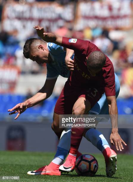Lazio's midfielder from Serbia Sergej MilinkovicSavic vies with Roma's defender from Brazil Bruno Peres during the Italian Serie A football match...