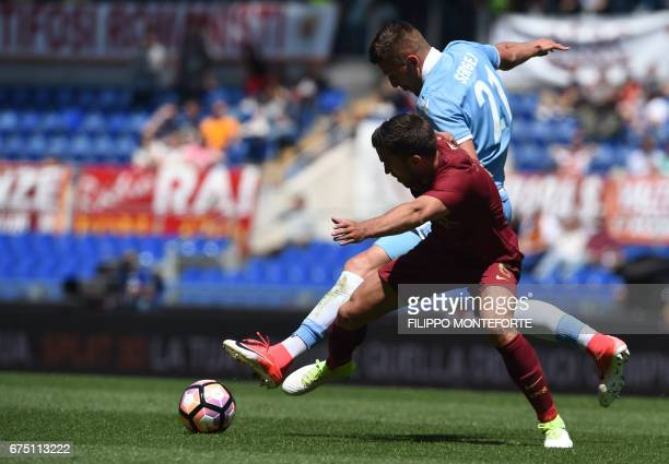 Lazio's midfielder from Serbia Sergej MilinkovicSavic vies with Roma's midfielder from Netherlands Kevin Strootman during the Italian Serie A...