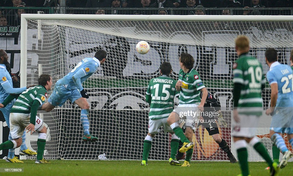 Lazio´s midfielder Libor Kozak (L) scores for the 3-3 draw after the UEFA Europa League football match VfL Borussia Moenchengladbach vs SS Lazio on February 14, 2013 in Moenchengladbach, western Germany.