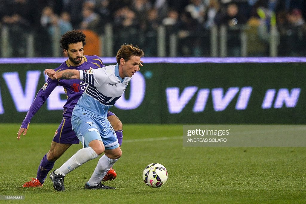 Lazio's midfielder Lucas Biglia fights for the ball with Fiorentina's midfielder Mohamed Salah during the Italian Serie A football match Lazio vs...