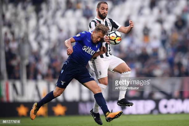 Lazio's midfielder Lucas Leiva Pezzini from Brazil fights for the ball with Juventus' forward Gonzalo Higuain from Argentina during the Italian Serie...