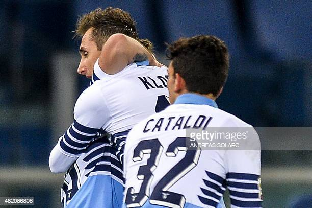 Lazio's midfielder Marco Parolo celebrates with teammates after scoring during the Italian Serie A football match between Lazio and AC Milan on 24...