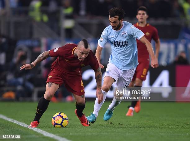 Lazio's midfielder Marco Parolo vies with Roma's Belgian midfielder Radja Nainggolan during the Italian Serie A football match AS Roma vs Lazio on...