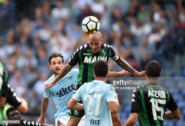 Lazio's midfielder Marco Parolo vies with Sassuolo defender Paolo Cannavaro during the Italian Serie A football match Lazio vs Sassuolo at the...