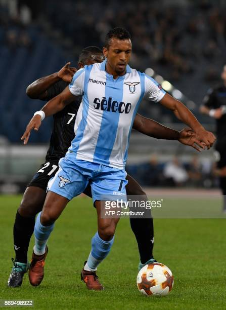 Lazio's midfielder Nani fights for the ball with Nice's French midfielder JeanVictor Makengo during the UEFA Europa League football match Lazio...