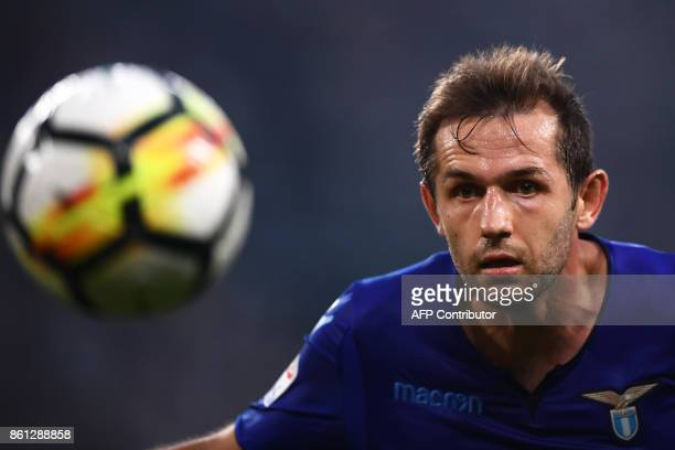 Lazio's midfielder Senad Lulic of Bosnia eyes the ball during the Italian Serie A football match Juventus Vs Lazio on October 14 2017 at the 'Allianz...