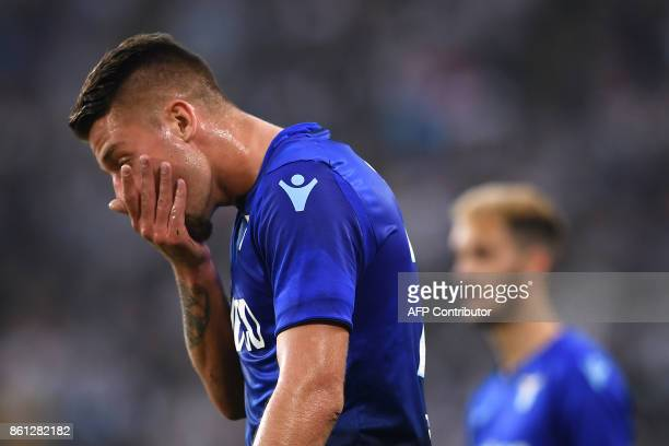Lazio's midfielder Sergej MilinkovicSavic from Serbia reacts during the Italian Serie A football match Juventus Vs Lazio on October 14 2017 at the...