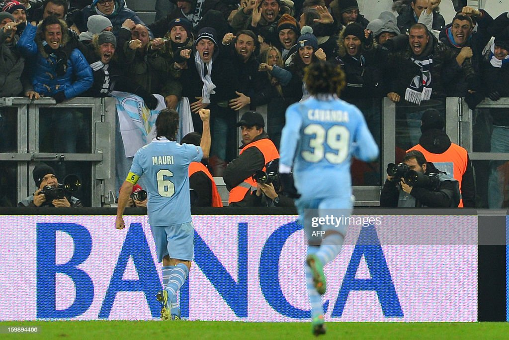Lazio's midfielder Stefano Mauri celebrates with fans after scoring a goal during the TIM CUP football match between Juventus and Lazio at the 'Juventus Stadium' in Turin on January 22, 2013.