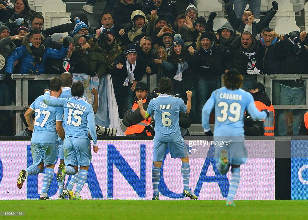 Lazio's midfielder Stefano Mauri (C) celebrates with fans after scoring a goal during the TIM CUP football match between Juventus and Lazio at the 'Juventus Stadium' in Turin on January 22, 2013.