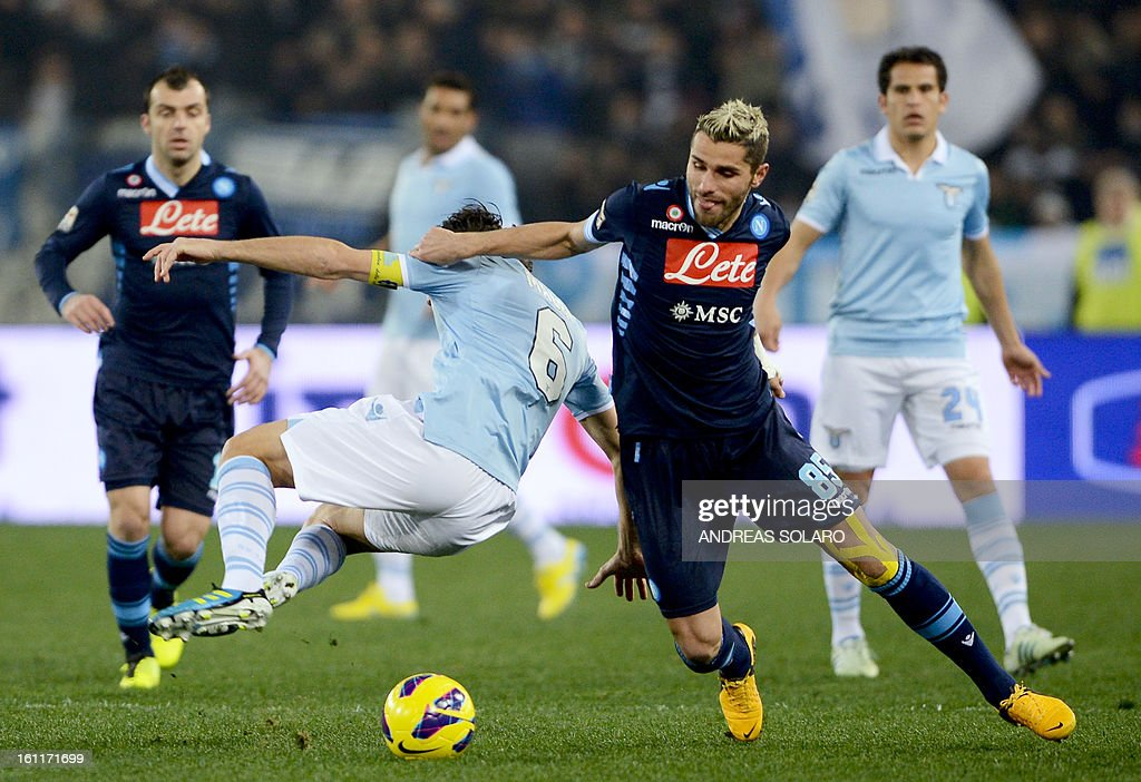 Lazio's midfielder Stefano Mauri (L) vies for the ball with Napoli's Swiss midfielder Valon Behrami during their Italian Serie A football match on February 9, 2013 at Rome's Olympic stadium.