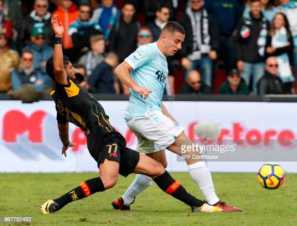 Lazio's Montenegro defender Adam Marusic fights for the ball with Benevento's Moroccan defender Achraf Lazaar during the Italian Serie a football...