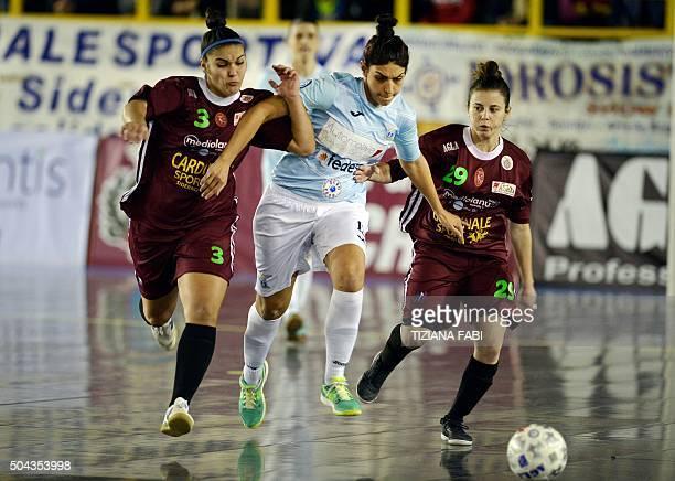 Lazio's Pamela Presto vies with Sporting Locri's Maria Soto and Noemi Viscoso during the women's futsal match between Sporting Locri and Lazio on...