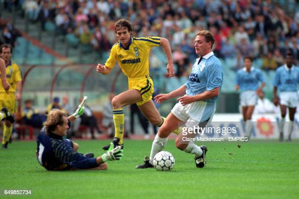 Lazio's Paul Gascoigne steams towards Parma's goalkeeper Claudio Taffarel