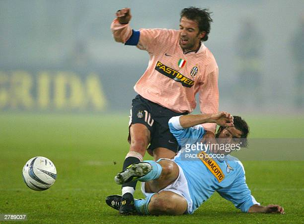 Lazio's player Giuliano Giannichedda tackles Juventus striker Alessandro Del Piero during their Serie A soccer match at Rome's Olympic stadium 06...