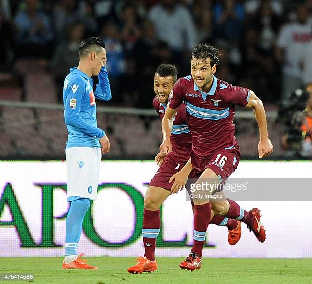 Lazio's player Marco Parolo celebrates after scoring a goal as Jose Maria Callejon of SSC Napoli looks dejected during the Serie A match between SSC...