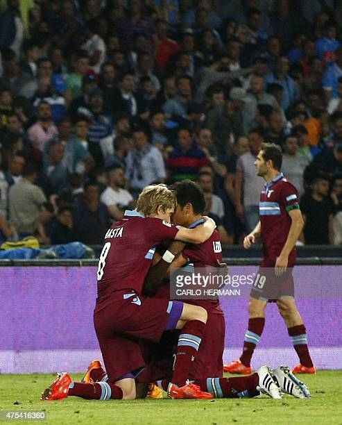 Lazio's players celebrate after scoring a goal during the Italian Serie A football match SSC Napoli vs SS Lazio on May 31 2015 at the San Paolo...