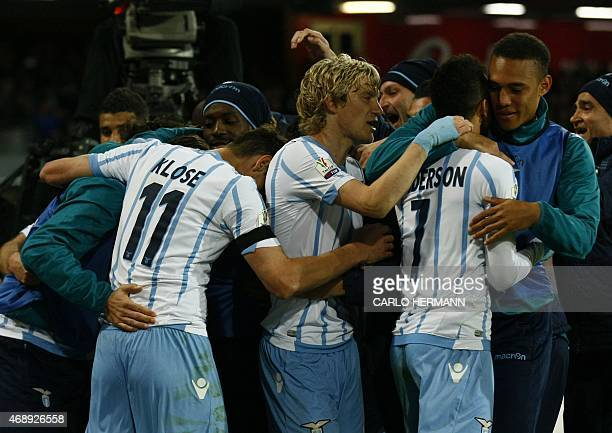 Lazio's players celebrate after scoring during the Italian Tim Cup semifinal second leg football match SSC Napoli vs SS Lazio on April 8 2015 at the...