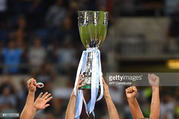 Lazio's players celebrate with the trophy after winning the Italian SuperCup TIM football match Juventus vs lazio on August 13 2017 at the Olympic...