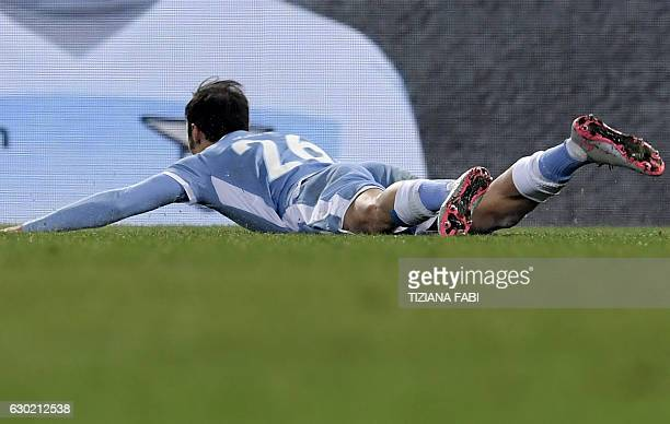Lazio's Romanian defender Stefan Radu celebrates after scoring a goal during the Serie A football match between Lazio and Fiorentina at Olympic...