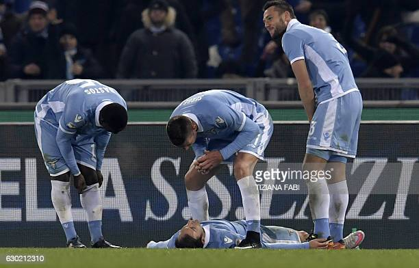 Lazio's Romanian defender Stefan Radu celebrates with teammates after scoring a goal during the Serie A football match between Lazio and Fiorentina...
