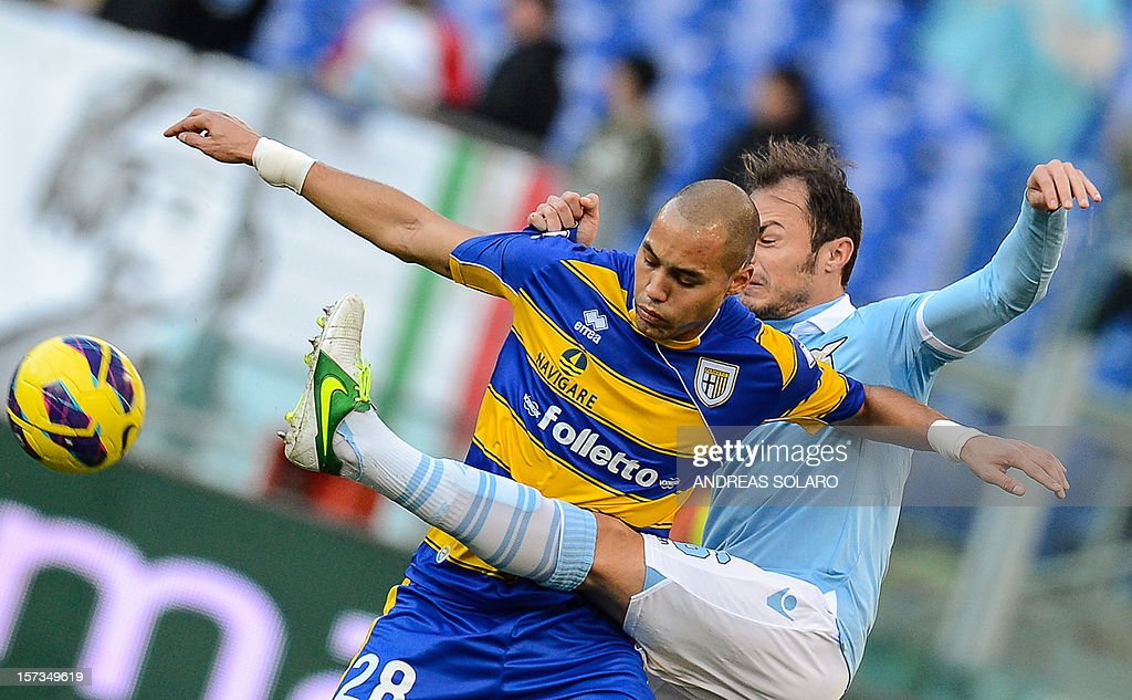 Lazio's Romanian defender Stefan Radu (R) fights for the ball against Parma's French defender Yohan Benalouane during their Italian Serie A football match on December 2, 2012 at Rome's Olympic stadium. Lazio won 2-1.