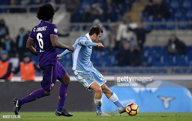 Lazio's Romanian defender Stefan Radu kicks to score a goal during the Serie A football match between Lazio and Fiorentina at Olympic Stadium in Rome...
