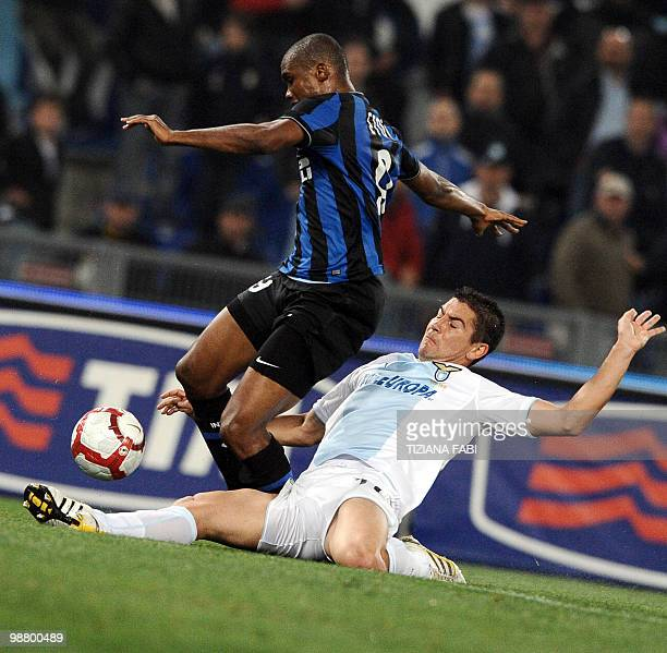 Lazio's Serbian defender Aleksandar Kolarov vies with Inter Milan's Cameroonian forward Samuel Eto'o during their Serie A football match at Olympic...