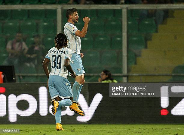 Lazio's Serbian forward Filip Djordjevic jubilates after scoring during the Serie A football match between Palermo and Lazio Roma at the Renzo...