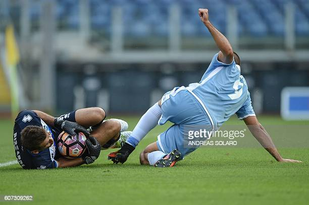 TOPSHOT Lazio's Serbian forward Filip Djordjevic tries to score against Pescara's Argentinian goalkeeper Albano Benjamin Bizzarro during the Italian...