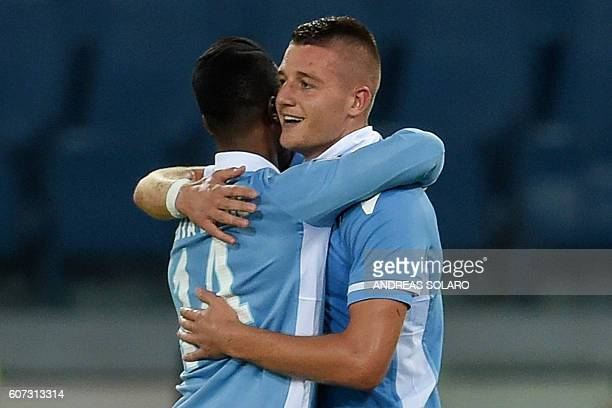 Lazio's Serbian midfielder Sergej MilinkovicSavic celebrates with Lazio's Senegalese forward Balde Diao Keita after scoring a goal during the Italian...