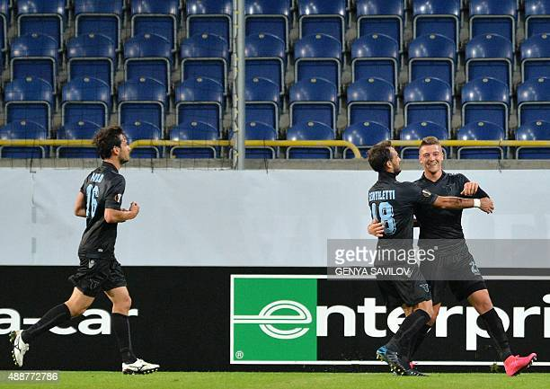 Lazios Sergej MilinkovicSavic celebrates with teammates after scoring a goal during the UEFA Europa League Group G football match between Dnipro...