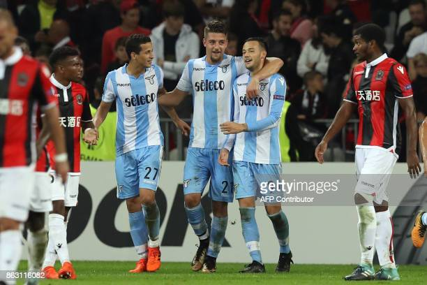 Lazio's Sergej MilinkovicSavic is congratulated by teammates after scoring a goal during the UEFA Europa League football match between Nice and Lazio...