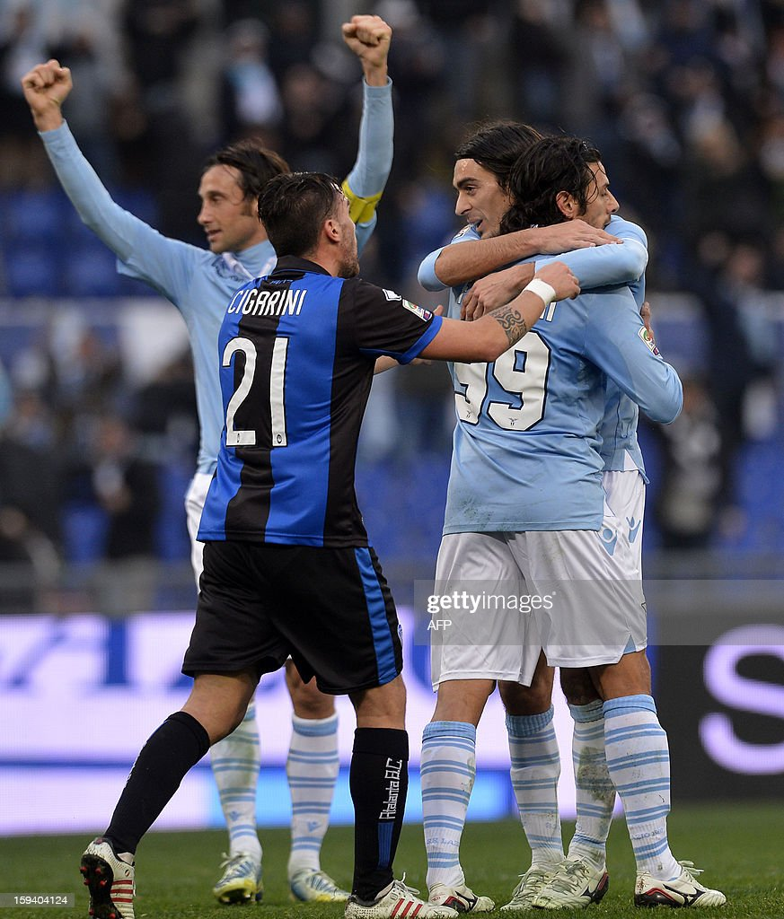 Lazio's Sergio Floccari celebrate with team mates after scoring a goal during an Italian Serie A football match between Lazio and Atalanta at the Rome's Olympic stadium on January 13, 2013.