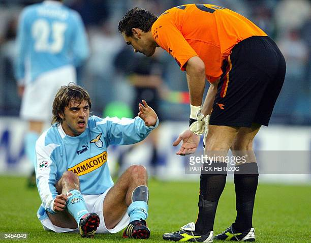 Lazio's Spanish forward Claudio Lopez reacts as AS Roma's goalkeeper Ivan Pelizzolli looks on during their Italian Serie A football match in Rome's...