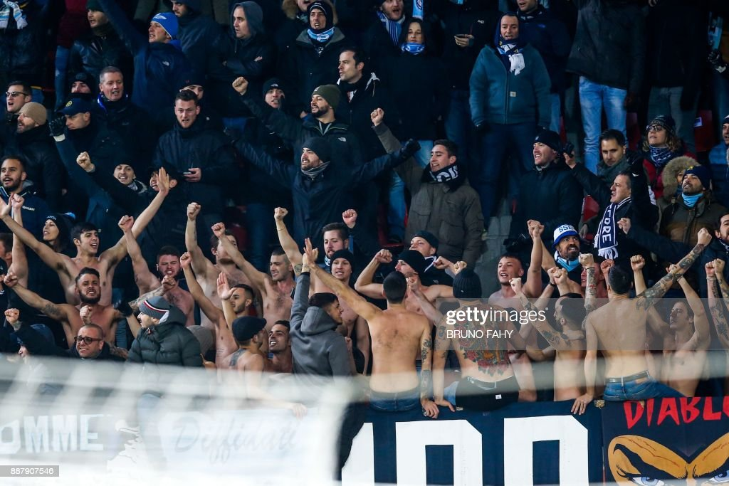 Lazio's supporters celebrate during the UEFA Europa League Group K football match between SV Zulte Waregem and Lazio at The Regenboogstadion in Waregem on December 7, 2017. / AFP PHOTO / Belga / BRUNO FAHY / Belgium OUT