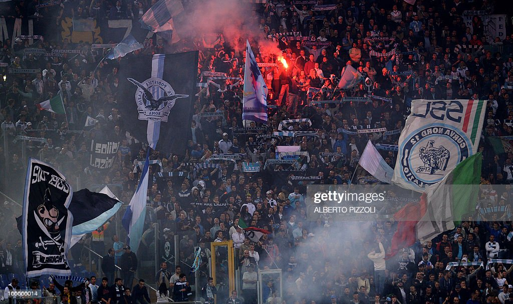 Lazio's supporters cheer during the Italian serie A football match between Lazio and Juventus on April 15, 2013 at the Olympic stadium in Rome. AFP PHOTO / ALBERTO PIZZOLI