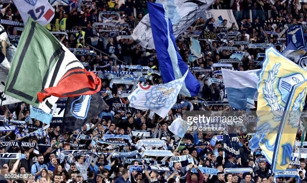 Lazio's supporters cheer on their team during the Serie A football match between Lazio and Napoli at Olympic Stadium in Rome on September 20 2017 /...