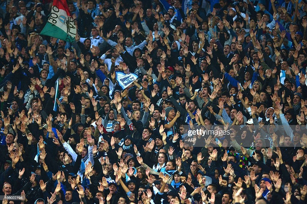 Lazio's supporters cheer their team prior the Italian Serie A football derby between Lazio Rome and AS Roma on November 11, 2012 at the Olympic stadium in Rome.