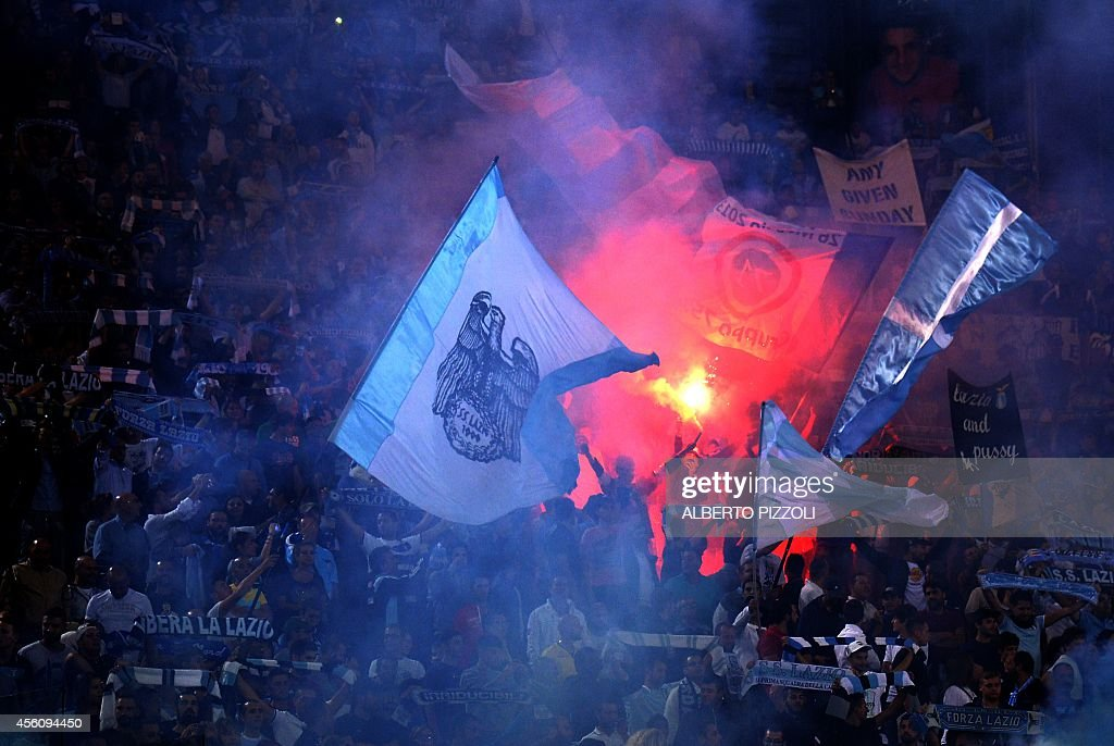Lazio's supporters wave flares during the Italian Serie A football match Lazio vs Udinese on September 25, 2014 at the Olympic stadium in Rome.
