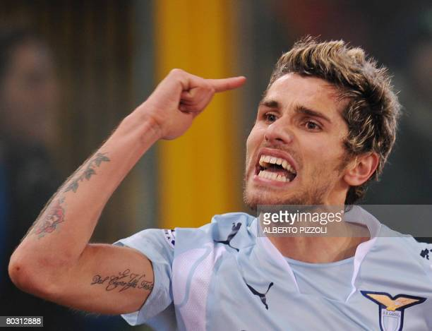 SS Lazio's Swiss midfielder Valon Behrami celebrates after scoring during a Lazio vs AS Roma Italian Serie A football match at Olympic Stadium in...