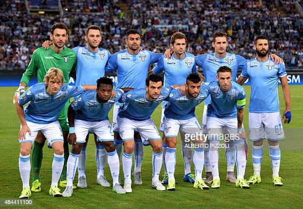 Lazio's team lines up ahead of the UEFA Champions League playoff football match between Lazio and Bayer Leverkusen at Olympic stadium in Rome on...