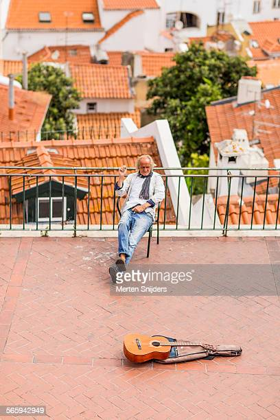 Lazy street musician on chair